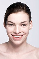 A smiling young woman with beautiful skin