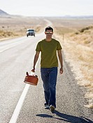 man walking with a gas can