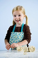 little girl kneading dough