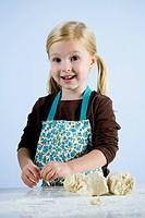 little girl kneading dough