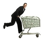 businessperson with a shopping cart full of money