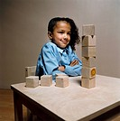 Girl with Toy Blocks