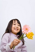 Studio shot of girl 2_3 holding flowers