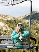 skier on a chairlift waiting for it to snow