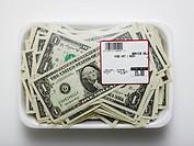 us dollars in a supermarket shrinkwrap package