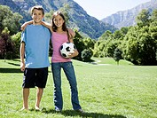 brother and sister with a soccer ball