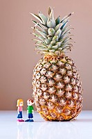 Girl and Boy Discussing Healthy Nutrition Pineapple