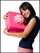 Close_up of a teenage girl holding a gift