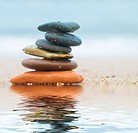 Stack of beach stones on sand