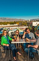 Friends having drinks on the rooftop patio of 'Bailey's on the Beach', Nob Hill, Albuquerque, New Mexico USA