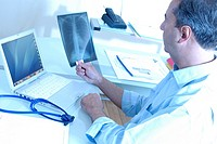 X-ray diagnosis  Doctor typing up the results of a patient´s chest X-ray