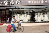 Shops selling western style wedding gowns in Suzhou, China  Suzhou is one of the largest producers of wedding dresses in the world
