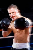 Portrait of a young man boxing