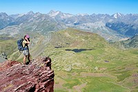 Hiker on the summit of Anayet, an old volcano in Tena valley  Formigal  Sallent de Gállego  Pyrenees  Huesca province  Aragón  Spain