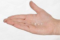 ´Help´ written on the palm of a child´s hand