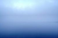 Mist over calm ocean