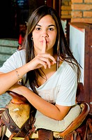 Young Woman with a Finger on her Lips