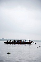 People in a boat on the Ganges River, India