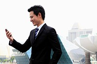Profile shot of man in business suit looking at a phone