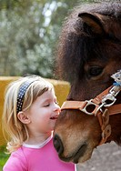 little blond girl loves her donkey funny portrait