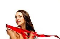 beautiful woman holding red ribbon with her finger