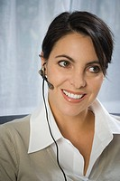 Close_up of a mid adult woman wearing a headset