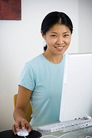 Portrait of a mid adult woman sitting in front of a computer