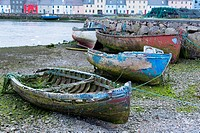 Old boats near the Claddagh with the Long Walk and Old Quays to the rear, Galway city, Ireland