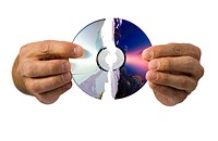 Close_up of a broken compact disk in a mans hand