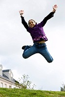 Low angle view of a girl jumping