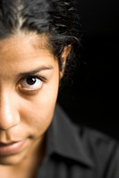 Close_up of a young woman staring