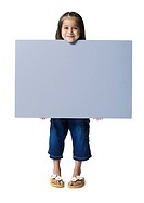 Portrait of a girl holding a blank sign
