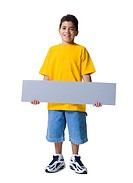 Portrait of a boy holding a blank sign