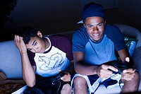 High angle view of a young men playing a video game