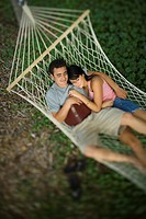 High angle view of a young couple sleeping in a hammock