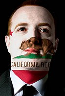 us state of california flag painted face of businessman or polit