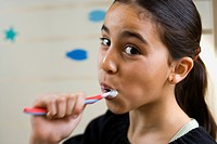 Close_up of a girl brushing her teeth