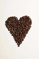 Coffee beans arranged in a heart shape