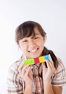 Girl holding HAPPY blocks