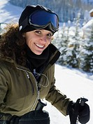 Woman with ski goggles outdoors in winter