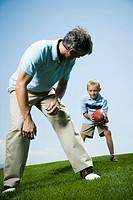 Man playing football with his son