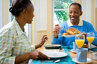 Senior man and a senior woman having breakfast