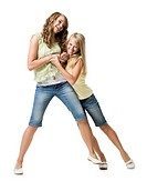 Two girls play fighting and smiling
