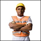Male road worker with crossed arms and hardhat