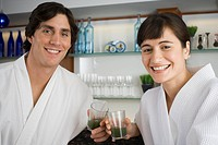 Portrait of a young couple holding glasses of wheatgrass juice