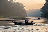 South America ,Brazil, Amazonas state, Manaus, Amazon river basin, rowboat sailing on a tributary creek of the Rio Negro , sunrise