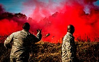 Staff Sgt  Brandon Washington, right, observes Tech  Sgt  Rudolph Stuart throw a smoke grenade during combat readiness training with the 628th Explosi...