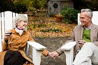Mature couple toasting outdoors