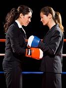 Businesswomen boxing