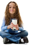 Young girl with a glass of milk